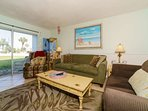 This large and bright living room has access to the open porch