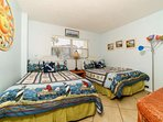 Second Bedroom has two full-sized beds and great beach decor