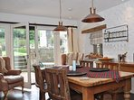 The open-plan dining space is the perfect back drop for dinner with friends