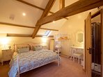 Romantic king-size bedroom with character beams and en-suite shower room