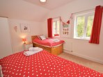 Colourful twin bedroom