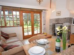 Open-plan lounge/kitchen/diner with woodburner