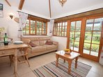 Lounge with french doors out to enclosed garden
