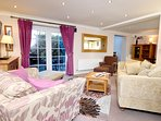 Lovely spacious lounge with french doors out to the patio