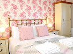 The pretty  double bedroom has the convenience of a modern ensuite shower room