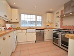 Kitchen with range style cooker
