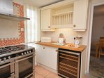 Kitchen with wine chiller leading to breakfast room