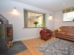 Lounge with contemporary woodburner