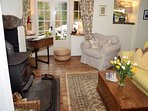 Snug sitting room with French windows into the pretty garden