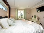 Relax in the comfy master bedroom and perhaps watch some TV