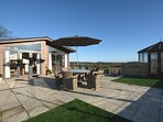Views towards the stylish lodge and housed hot tub