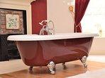 Roll-top bath tub