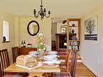The dining Room at Elk Cottage has French doors opening out onto a lawned area