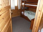 Manx 2nd bedroom with bunk beds wardrobe and room for 'z' bed or cot.