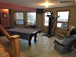 Pool room on the lower level.