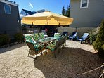 South Facing Backyard with Dining Table for 8 w/Full Seat Cushions & 11.5' Parasol at LBHM
