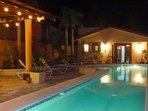 Casita at night with lap pool