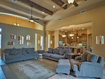 High ceilings with wood beams highlight the living room.