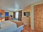 Lounge on this cozy queen bed and watch a movie on the flat-screen Smart TV.
