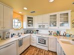 The kitchen includes modern appliances and a charming shiplap backsplash.