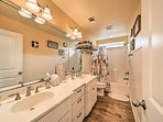This spacious bathroom is highlighted by a double wide vanity.