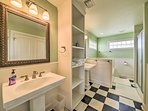 The second full bathroom features a walk-in shower and separate soaking tub.