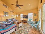 Vaulted ceilings soar over the living area, complete with a flat-screen TV.