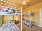 Outfitted with 2 twin-over-twin bunk beds, this first bedroom is great for kids.