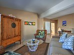 The breezy interior features plush furnishings and vibrantly hued decor.