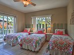 Picket fence headboards accompany the 3 twin beds.
