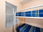 Twin size bunks are featured in the bunk room.