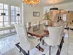 Gather around this dining room table to feast.