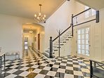 Step inside, where you're greeted by a wonderful staircase.