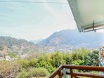 The view of the Bhimtal hills from the balcony of this vacation home in Bhimtal