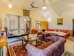 The expansive master bedroom with antique furniture, king-size bed and a private balcony