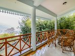 The private balcony attached to the master bedroom of this holiday home in Bhimtal