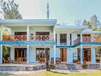 The front facade of this holiday villa in Bhimtal with a beautiful porch
