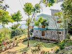 This Vacation home in Bhimtal is surrounded by greens from all around with tall trees