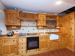 Custom Kitchen with Dish washer, Fridge, Microwave and Washing Machine