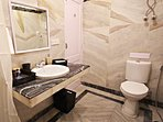 An attach bathroom with the ground floor bathroom comes with all amenities