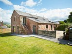 Elk Cottage is a 5* rated Grade II listed sandstone cottage with two ensuite BRs and wood fire