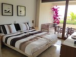 En suite master bedroom. All bedrooms have direct access to the terrace.