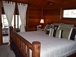 Bedroom with king bed and access to sunroom