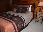 Bedroom with queen bed and twin bunk set