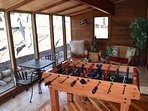 Sunroom with seating and foosball