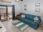 Tiled living room with sleep sofa