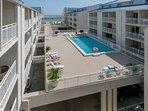 Private balconies overlooking pool area