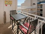 Al fresco dining with a view of the community pool and Gulf