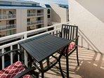 Private balcony with al fresco dining set