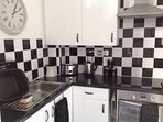 Well equipped kitchen with oven, hob, extractor, fridge freezer and washer dryer